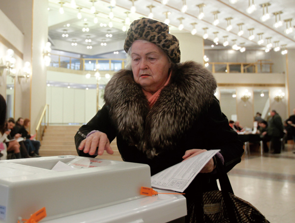 A Russian woman casts her ballot at a polling station in Moscow on Sunday, March 4, 2012. Polling stations have opened across Russia's vast expanse fo...