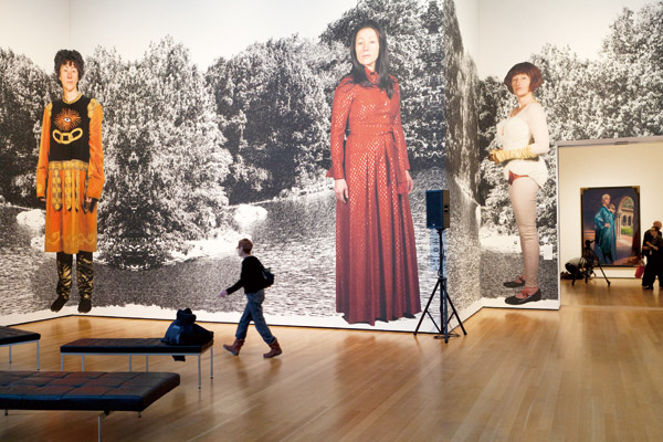 A visitor passes by one of Cindy Sherman's murals at the press viewing of Sherman's show at the Museum of Modern Art in New York, Feb. 21, 2012. The m...