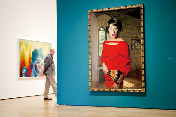 A visitor passes one of Cindy Sherman's clown pieces at the press viewing of Sherman's show at the Museum of Modern Art in New York, Feb. 21, 2012. (T...
