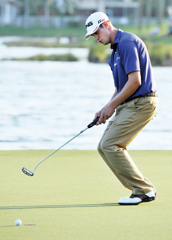 Harris English reacts after missing a birdie putt on the 18th green during the third round of the Honda Classic golf tournament in Palm Beach Gardens,...