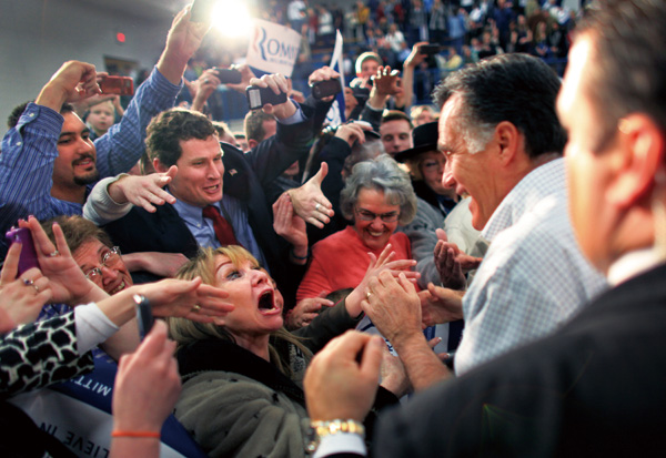 Former Massachusetts Gov. Mitt Romney, a candidate for the Republican presidential nomination, greets supporters during a rally at the Skyline High Sc...