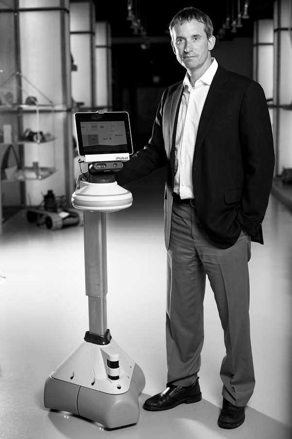 Colin Angle, the chief executive of the iRobot Corporation, with Ava, a 5-foot-4-inch assistant with a tablet for a brain and Xbox motion sensors to h...