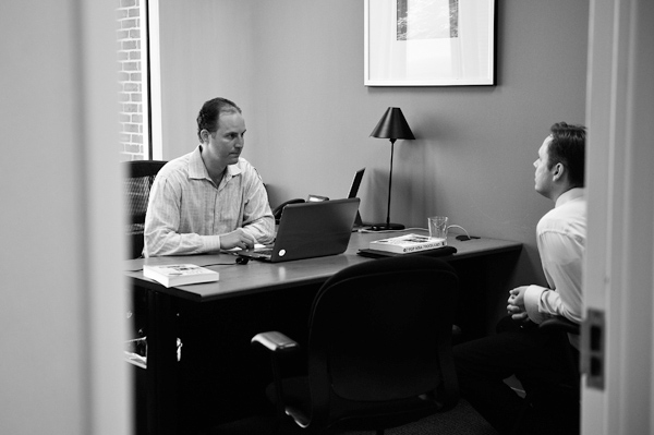 David Petersam, left, president of AdmissionsConsultants, meets with a prospective MBA candidate in Vienna, Va., Feb. 22, 2012. (The New York Times)