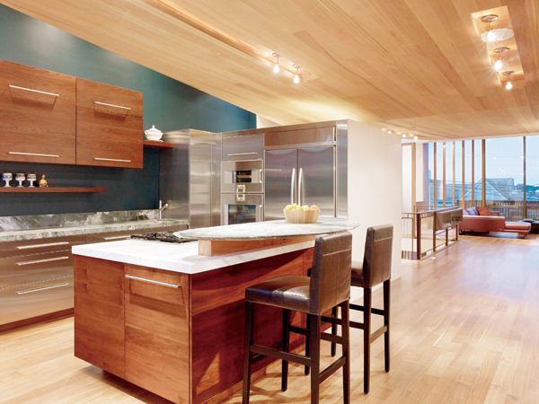 An expanded kitchen space that joins the rest of the living area at the renovated home of the general contractor and developer, Gerry Agosta and his w...
