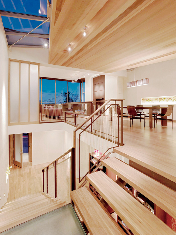 The open living area, seen from the main stairway, at the renovated home of the general contractor and developer, Gerry Agosta and his wife, Lisa More...