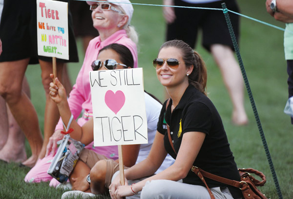 Fans of Tiger Woods line the second fairway during the opening round of the Honda Classic at PGA National Resort and Spa in Palm Beach Gardens, Florid...