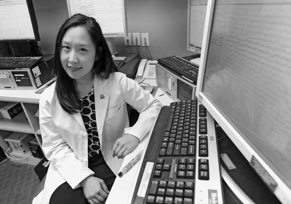 Dr. Tricia Ting, assistant professor of neurology at University of Maryland School of Medicine, is pictured with seizure monitoring units at Universit...