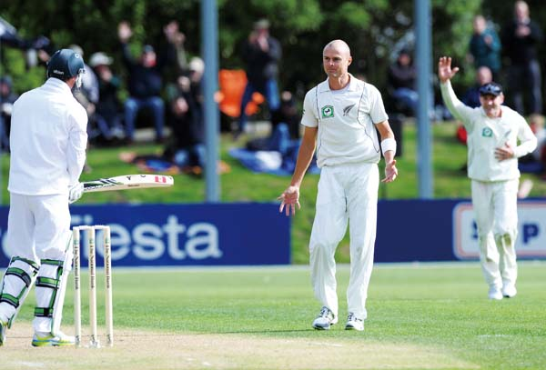 New Zealand's Chris Martin, center, successfully dismisses South Africa's AB de Villiers lbw for 0 on the first day of the first International Cricket...