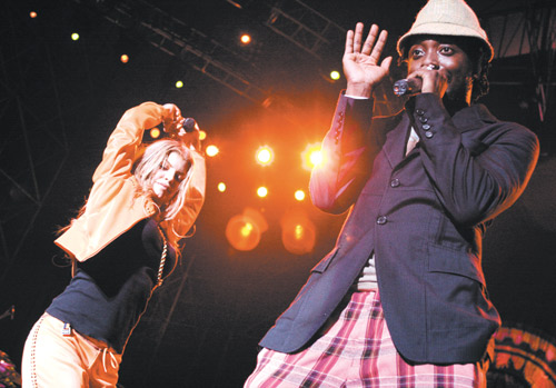 Fergie, left, and will.i.am, members of the American rap band Black Eyed Peas, perform during their concert in Taipei on Tuesday, July 25, 2006.