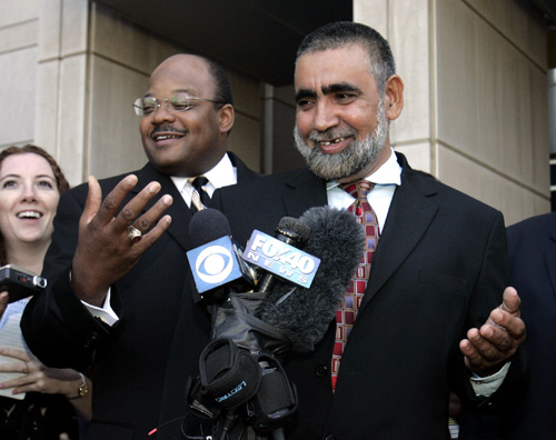 Umer Hayat, right, and his attorney, Johnny Griffin, III, left, talk with reporters on Friday. Umer Hayat was released from custody after he was sente...