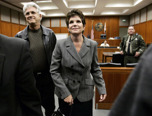 Patricia Dunn, former chairman of Hewlett-Packard (HP), leaves Superior Court with her husband Bill Jahnke after answering charges in San Jose, Califo...