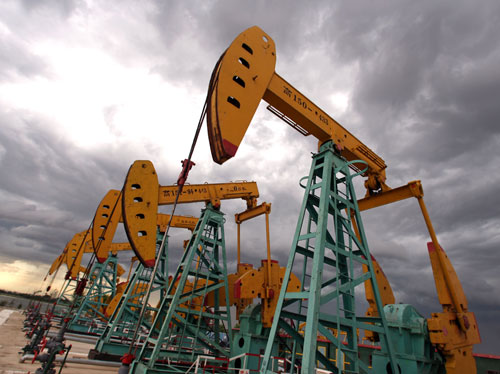"""CNPC """"nodding donkeys"""" oil pumps pump oil during a storm in Daqing, Heilongjiang province, China on July 13, 2006. The city, once a model for China's ..."""