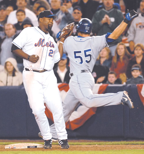 The New York Yankees's Carlos Delgado, left, puts the tag on the Los Angeles Dodgers' Russell Martin during the ninth inning in Game 2 of their Nation...