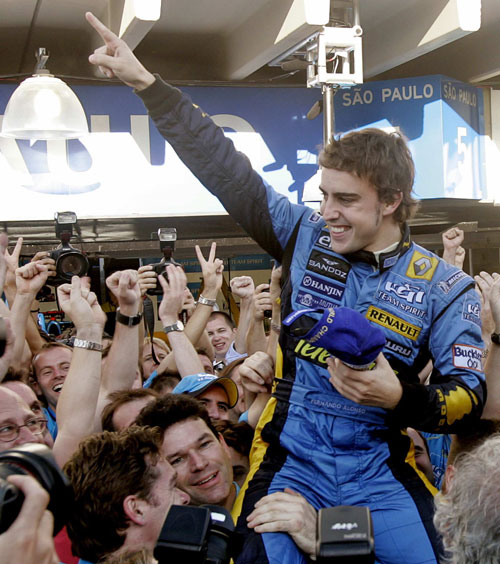 Renault's Formula One driver Fernando Alonso of Spain celebrates with the Renault team after finishing second in the Brazilian Grand Prix, the last F1...