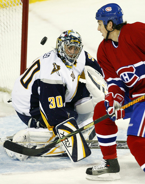 Buffalo Sabres goaltender Ryan Miller makes the save off Montreal Canadiens Mike Johnson during first period NHL action in Montreal on Monday.