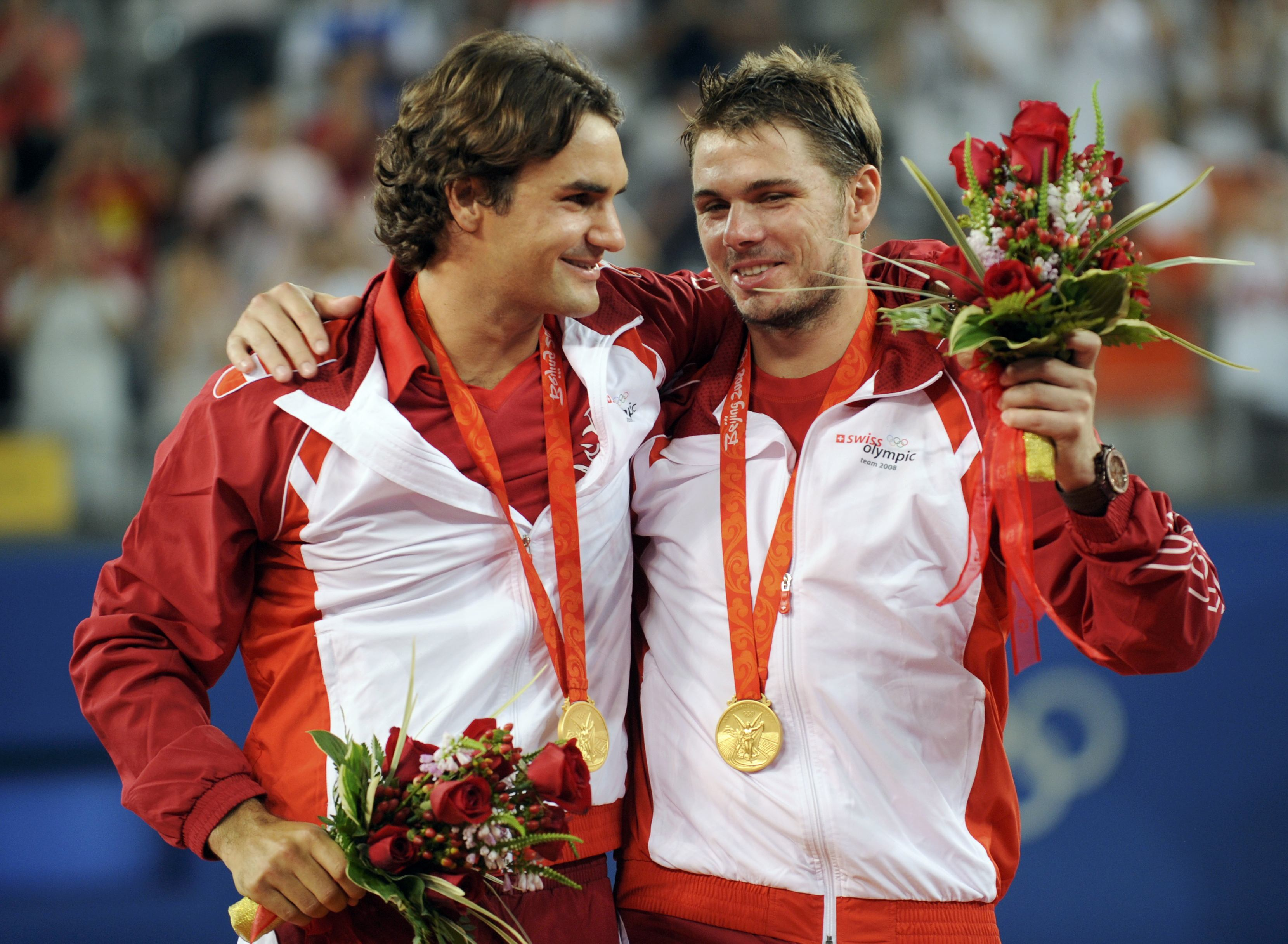 Switzerland's Stanislas Wawrinka, right, and Roger Federer stand with their gold medals during the medal ceremony for the men's tennis doubles at the ...