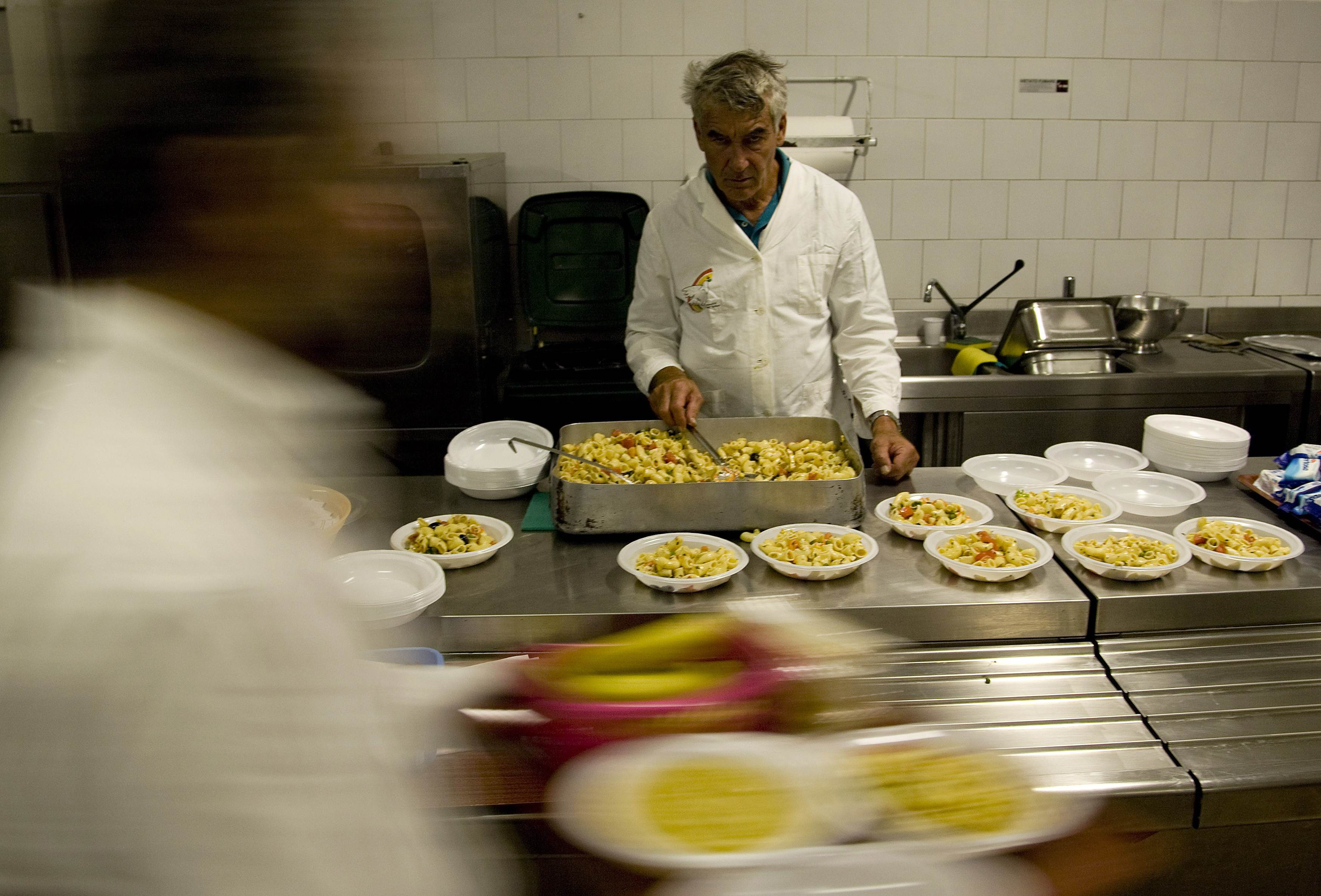 Free meals are served in a 'soup kitchen' run by the Sant'Egidio Christian community in Rome, Italy on Sept. 17.