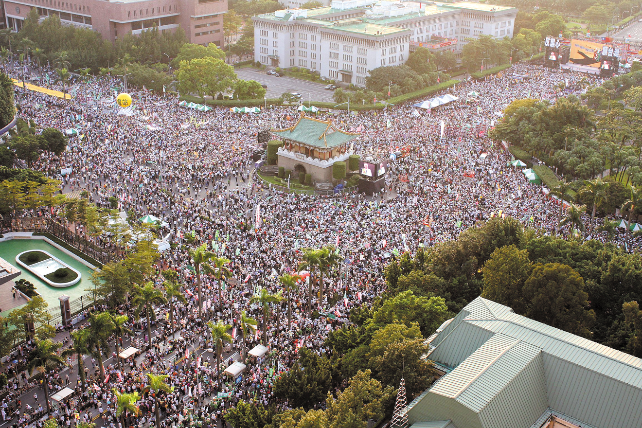 Thousands of protesters gather along Ketegelan Boulevard in front of the Presidential Office yesterday.