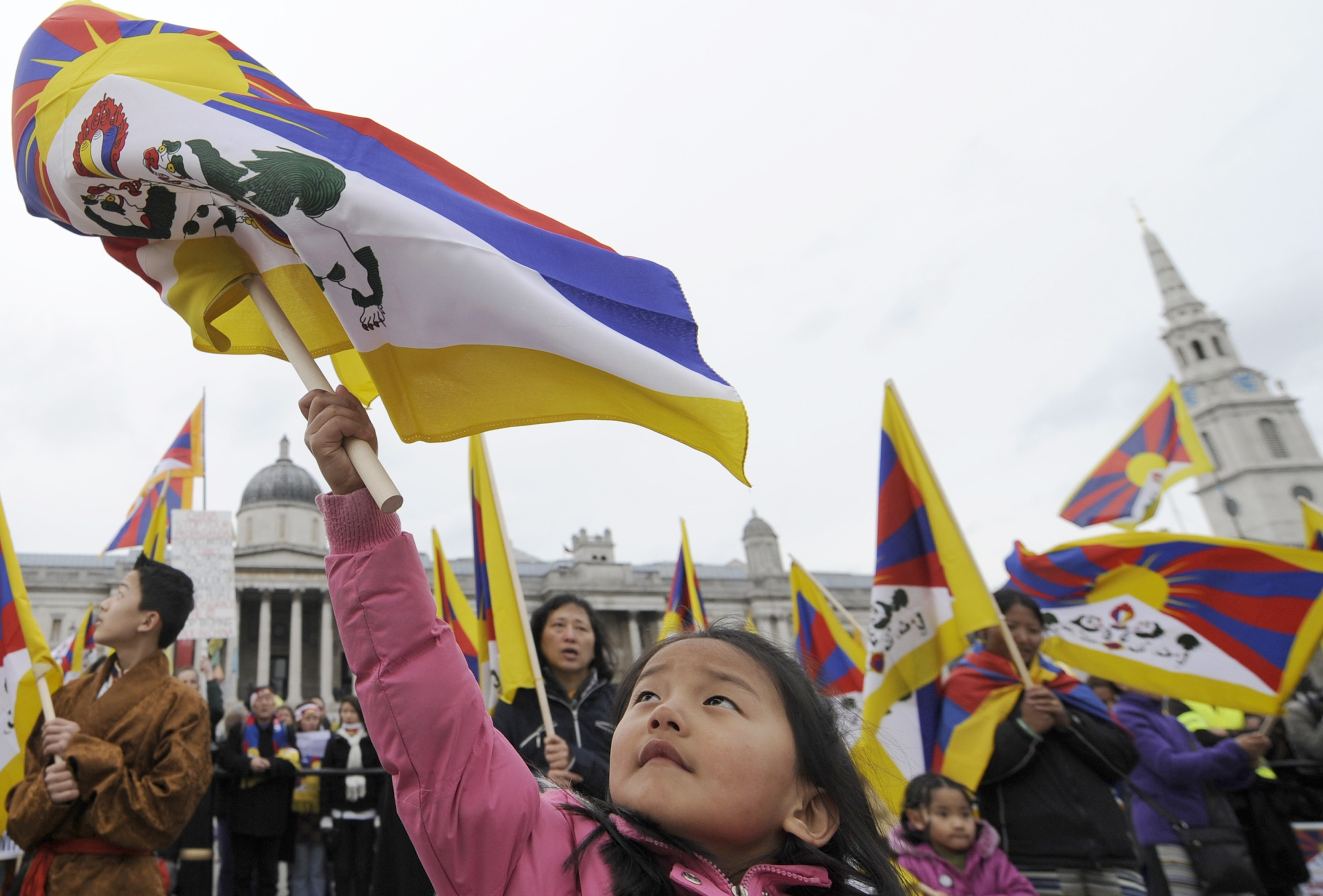 A young demonstrator waves a Tibetan flag during speeches at a pro-Tibetan march and rally in Trafalgar Square in central London, England on Saturday.