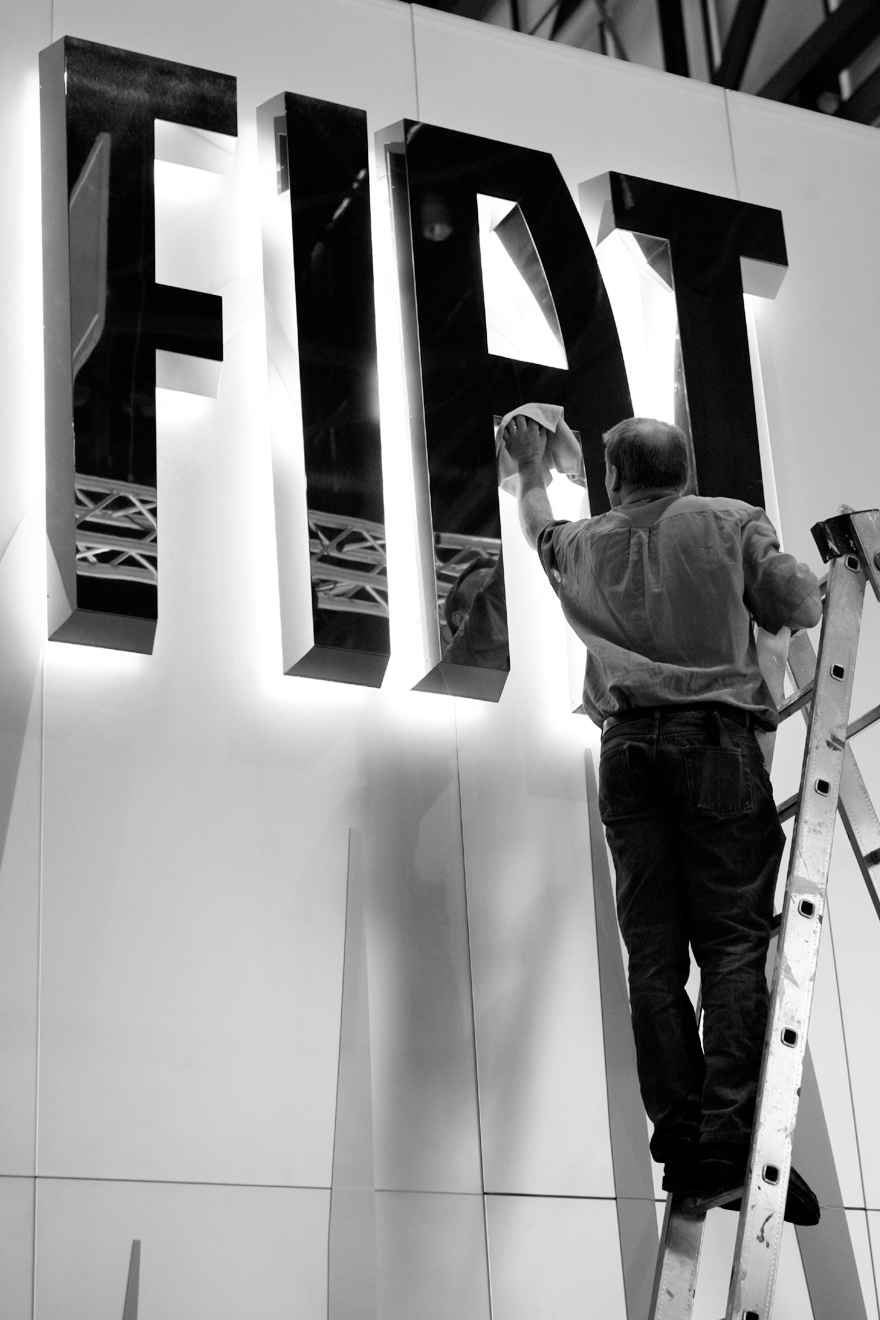 An employee cleans a Fiat logo prior to the 79th Geneva International Motor Show in Geneva, Switzerland on March 2.