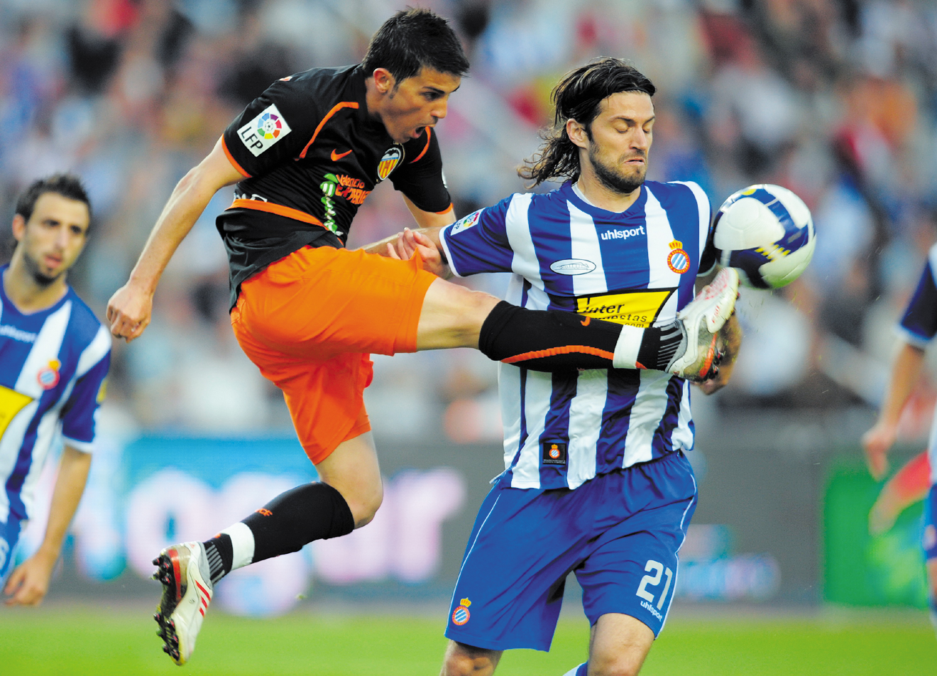 Valencia's David Villa, right, duels for the ball with Espanyol's Daniel Jarque during their Spanish La Liga soccer match at Lluis Companys Stadium in...