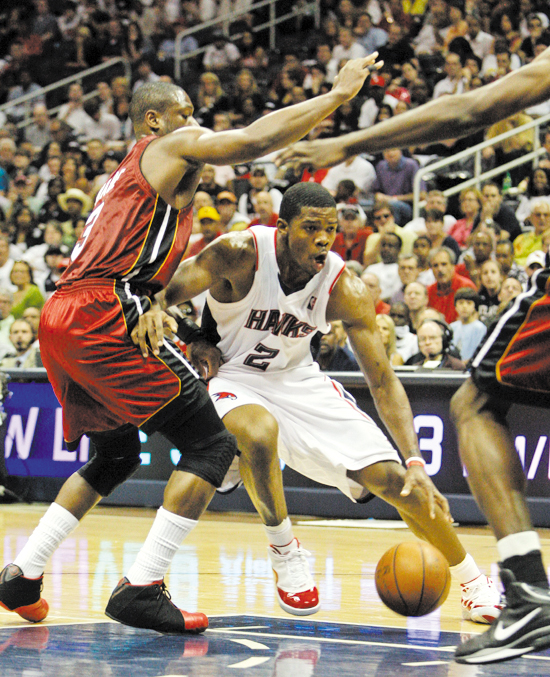 Atlanta Hawks' Joe Johnson (2) works to get around Miami Heat's Dwyane Wade, left, in the first quarter of Game 7 of the Eastern Conference NBA basket...