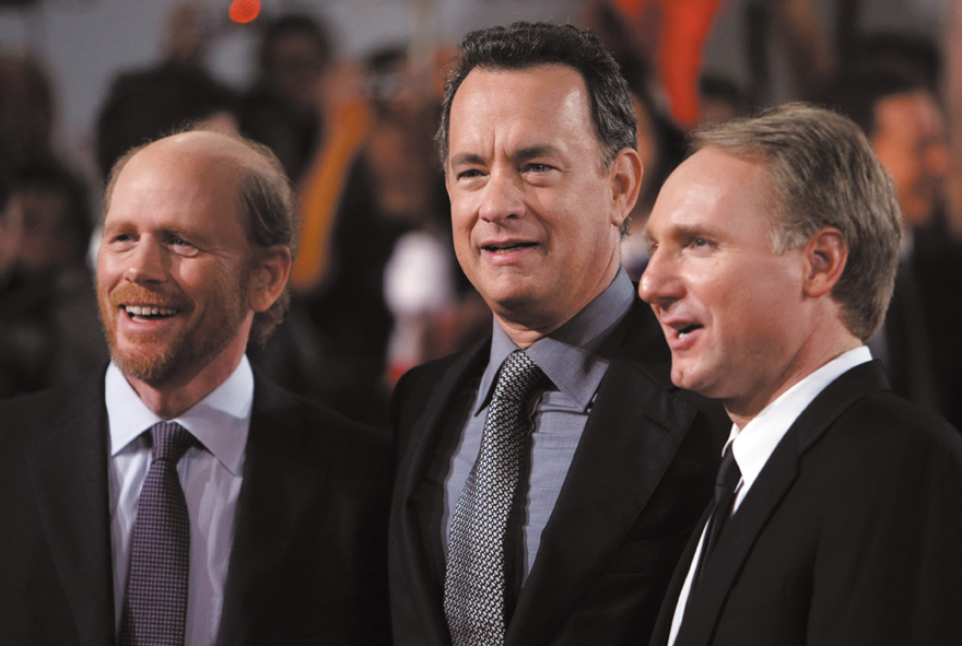 U.S. director Ron Howard, left, U.S. actor Tom Hanks, center, and U.S. author Dan Brown, right, arrive for the world premiere of 'Angels & Demons', in...