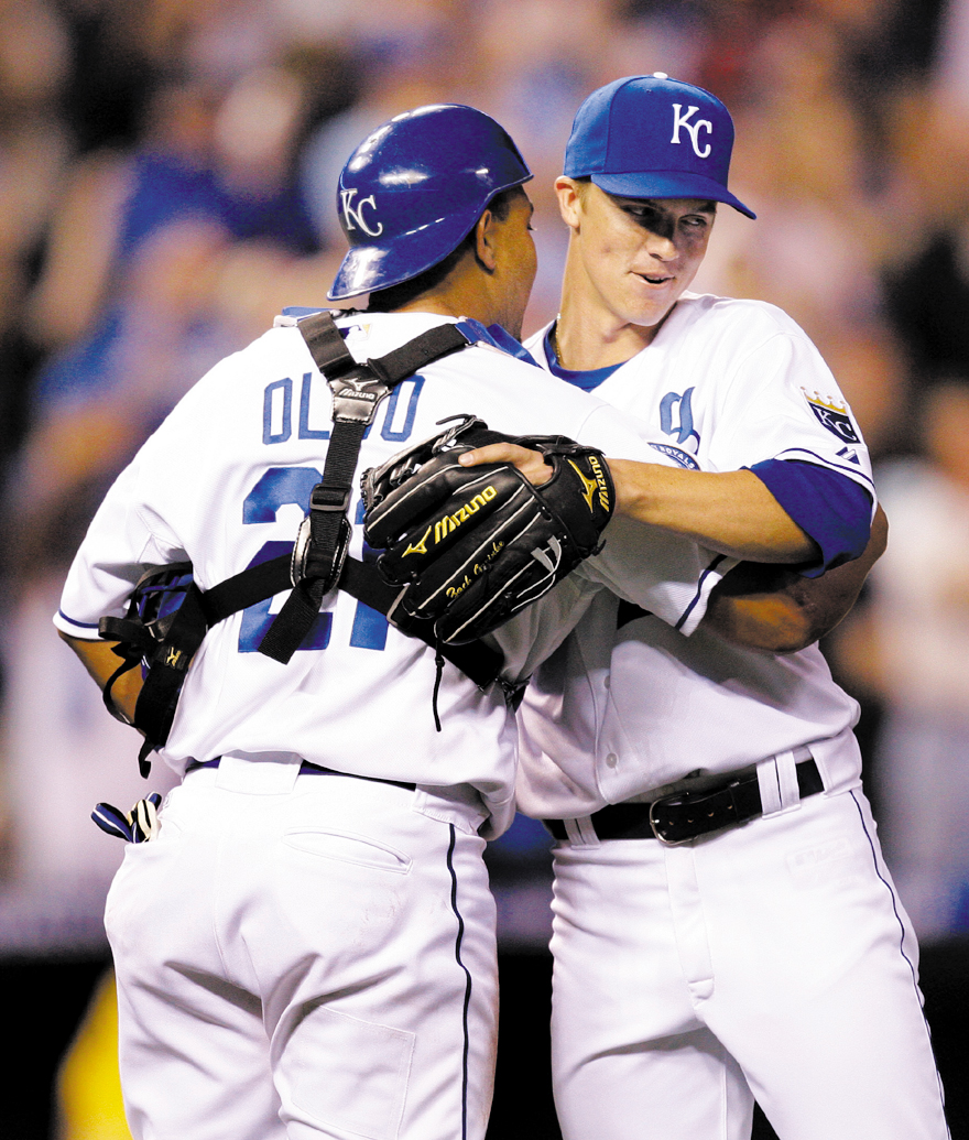 Kansas City Royals starter Zack Greinke, right, celebrates with catcher Miguel Olivo after pitching a complete game shutout in a baseball game against...