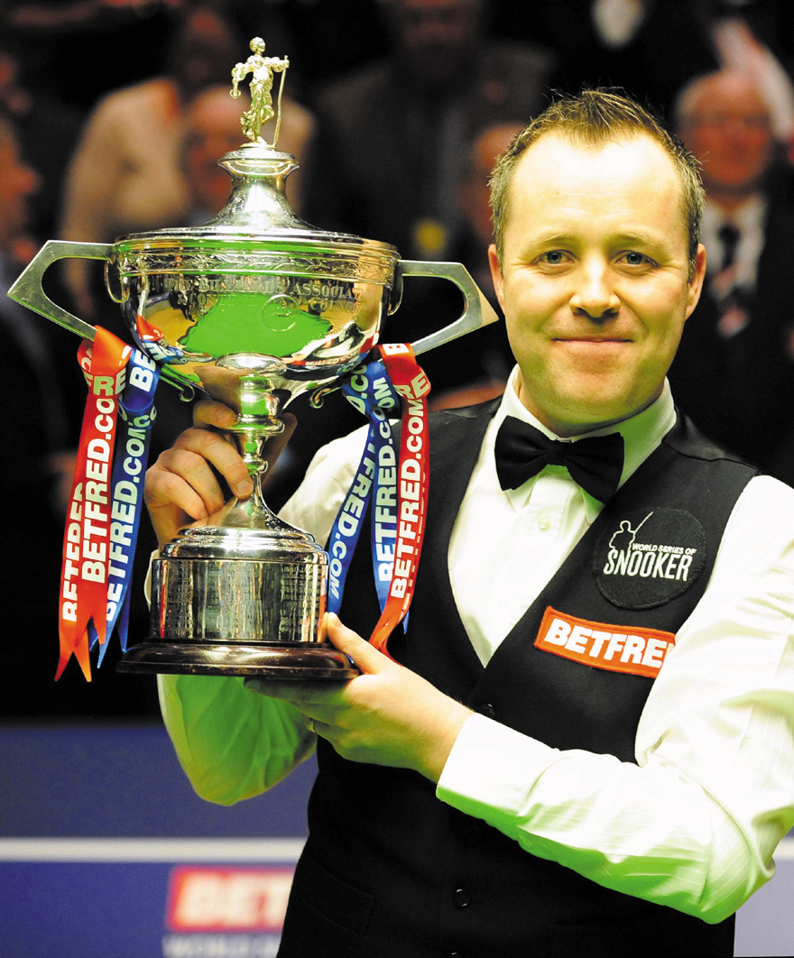 Scotland's John Higgins poses with his trophy after winning the final of the World Snooker Championships at The Crucible, Sheffield, England on Monday...