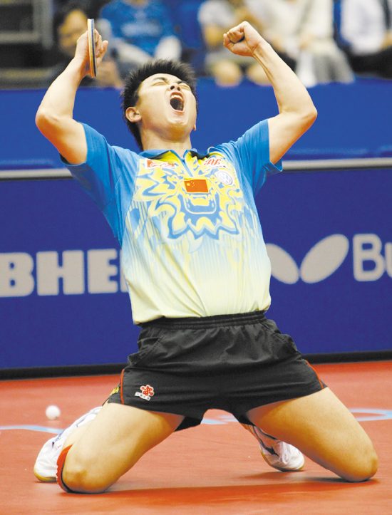 Wang Hao of China reacts after defeating his compatriot Wang Liqin during the final match of the men's singles in the World Table Tennis Championships...