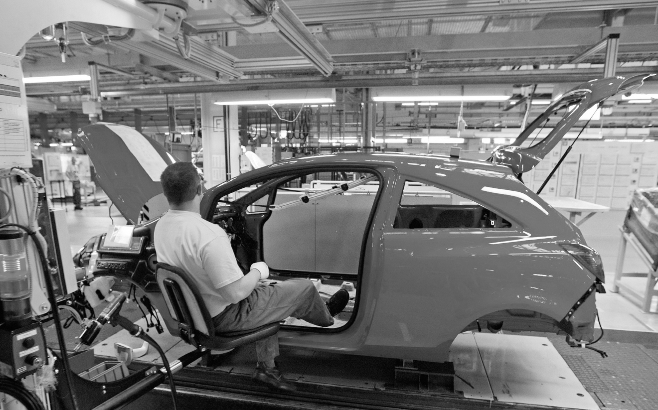 A worker assembles an Opel Corsa car at the Opel factory, owned by General Motors Corp., in Eisenach, Germany on Monday.