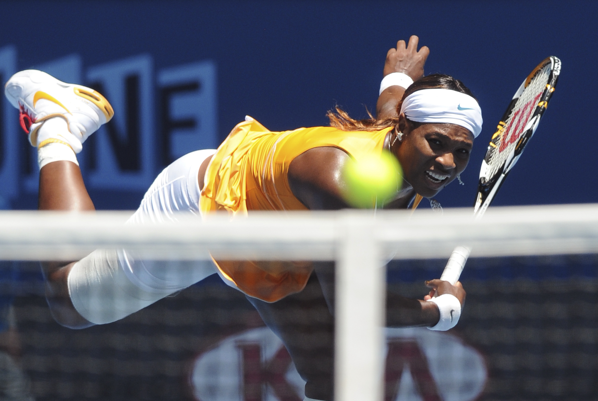 Serena Williams of the U.S., serves to Li Na of China during her Women's singles semifinal match at the Australian Open tennis tournament in Melbourne...