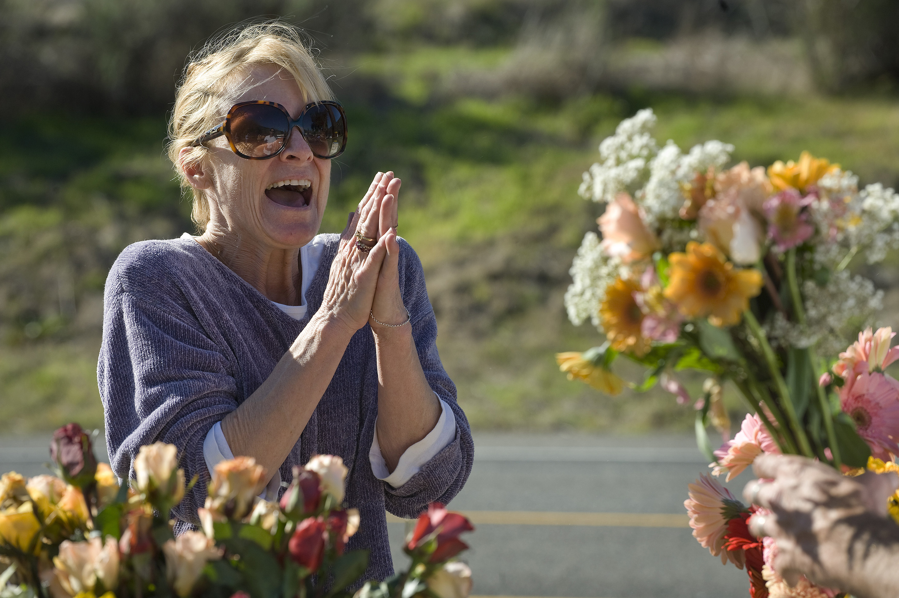 'Free flowers, what a treat,' exclaimed Melissa Bellano of Laguna Beach, California, after receiving the flowers from Shaun Kieran on Laguna Canyon Ro...