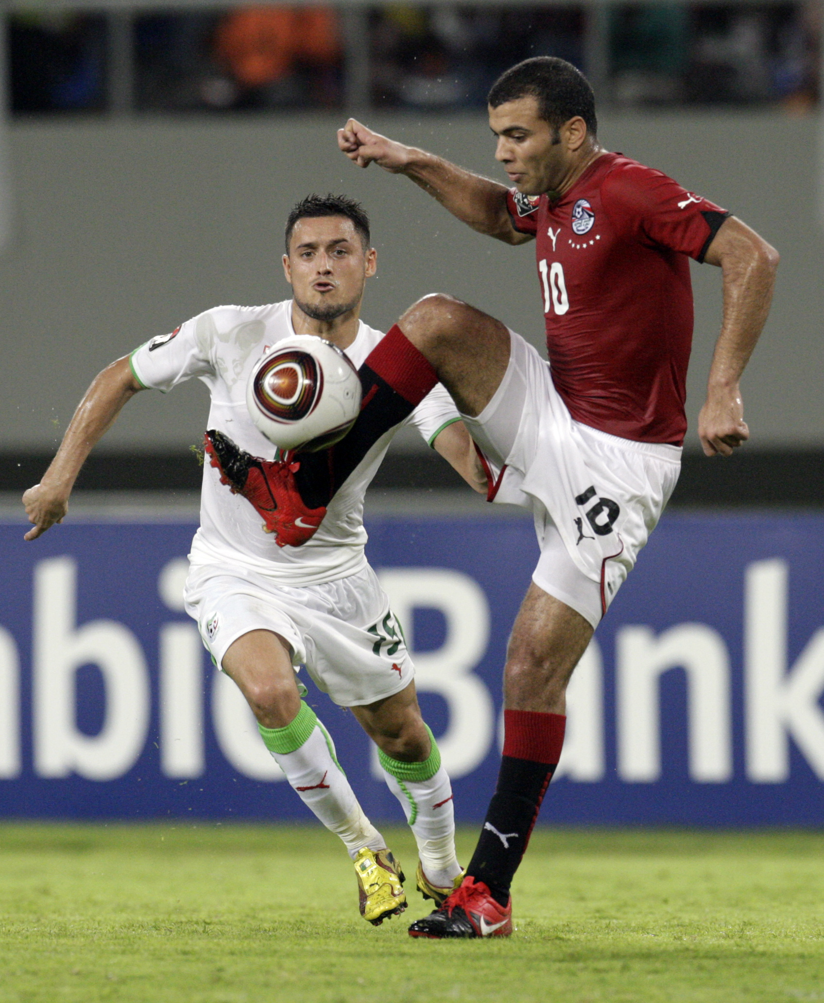 Algeria's Karim Ziani, left, looks on as Egypt's Emad Meteab, traps the ball during the semi-finals of their African Cup of Nations soccer match at th...
