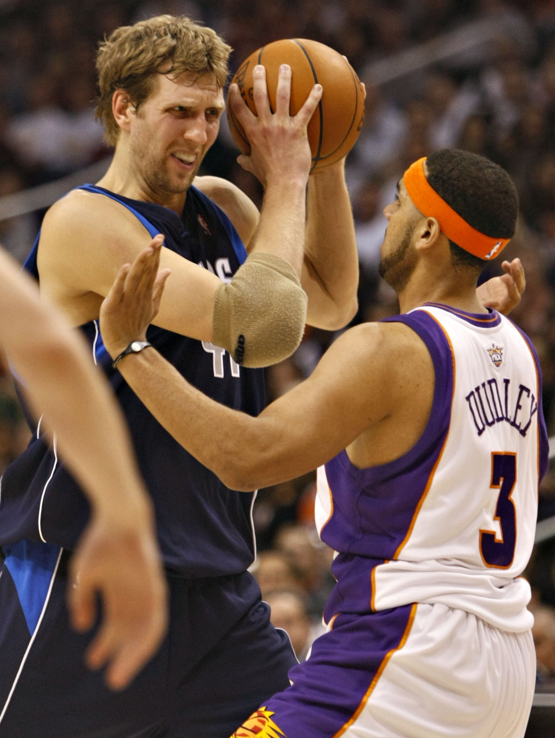 Dallas Mavericks' Dirk Nowitzki, left, looks to drive against Phoenix Suns' Jared Dudley during the first quarter of an NBA basketball game on Thursda...