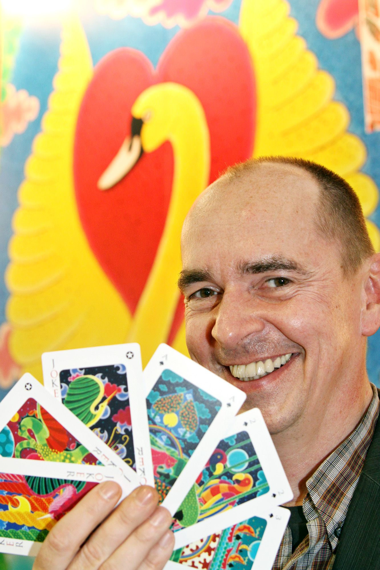 Artist Atelier Wolfgang Nocke displays cards which comes with his new book 'Fabelspiel' during an interview on Thursday.