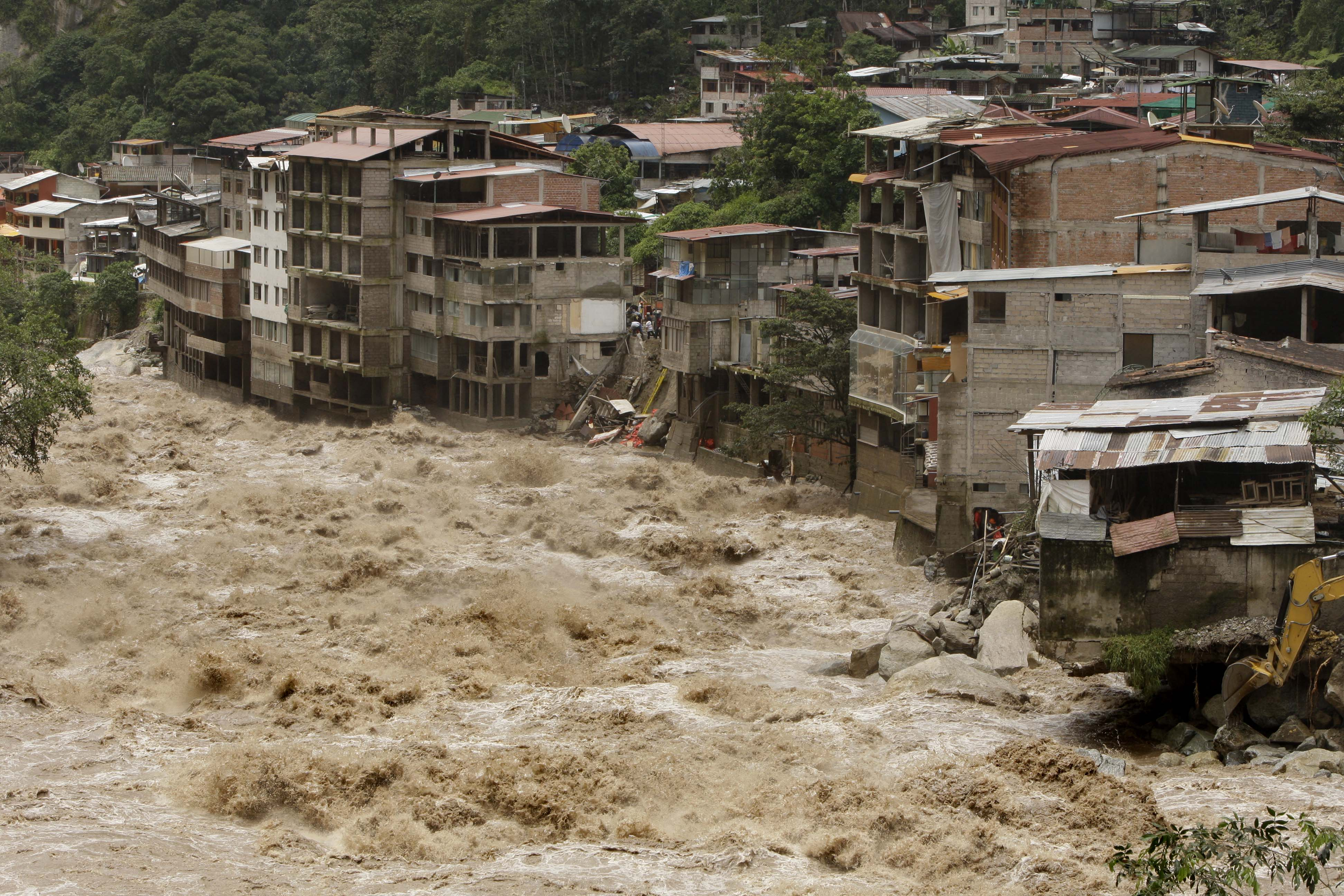 The overflowed Urubamba river passes next to the Machu Picchu Pueblo archeological site in Cuzco, Peru on Thursday.