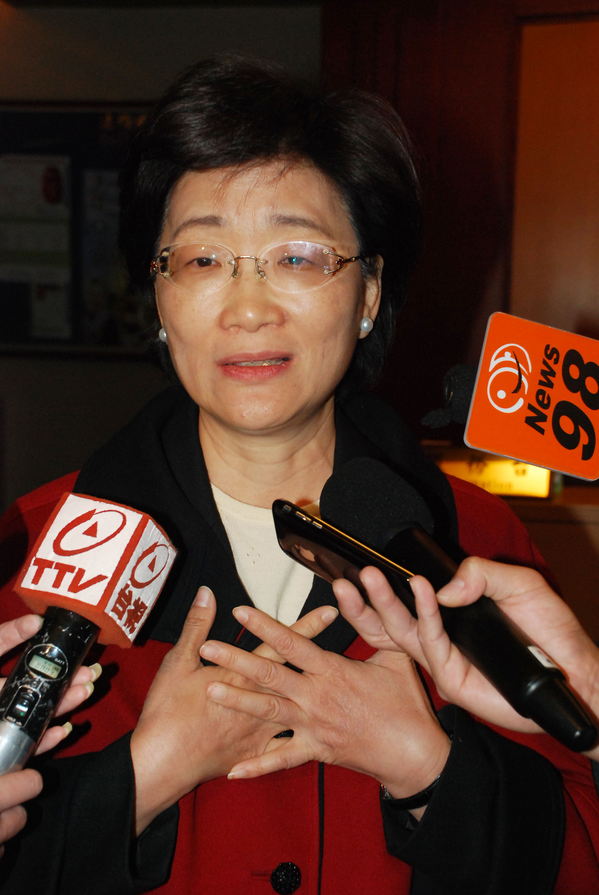 Wang speaks to reporters yesterday.