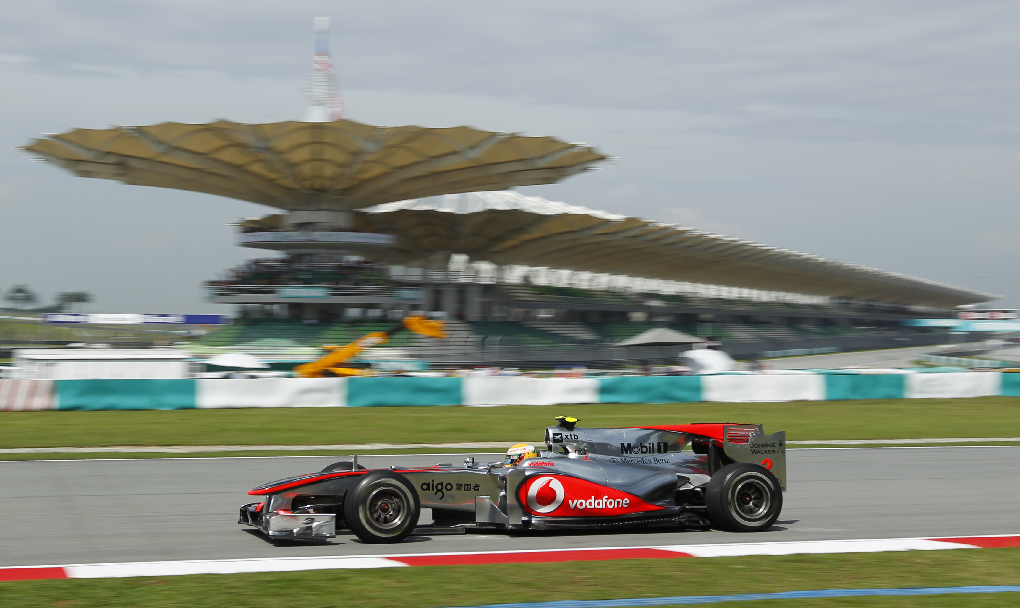 McLaren Formula One driver Lewis Hamilton of Britain in action during the first practice session for the Malaysian Formula One Grand Prix in Sepang, M...