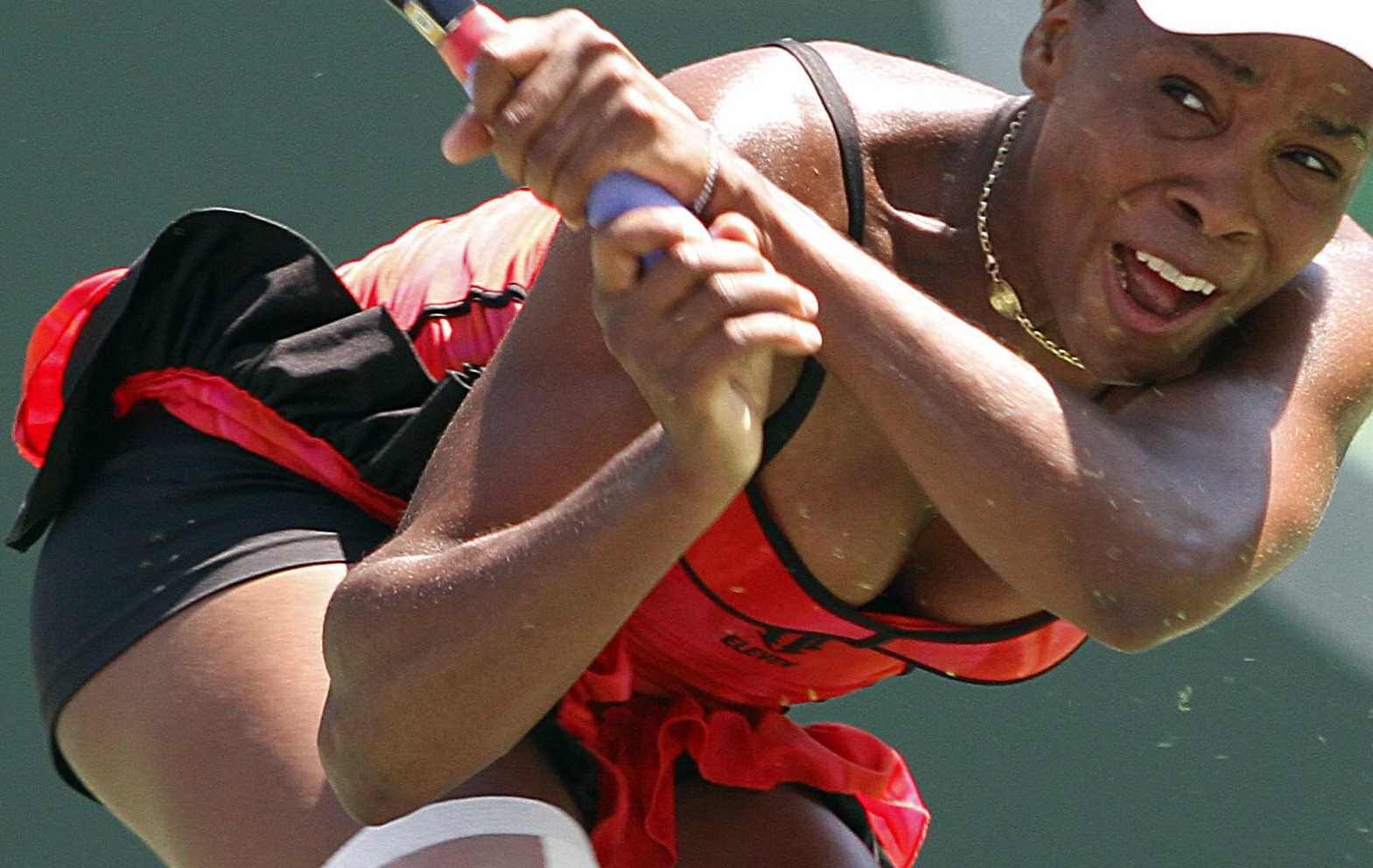 Venus Williams returns the ball to Marion Bartoli during their match at the Sony Ericsson Open tennis tournament in Key Biscayne, Fla. Thursday, April...
