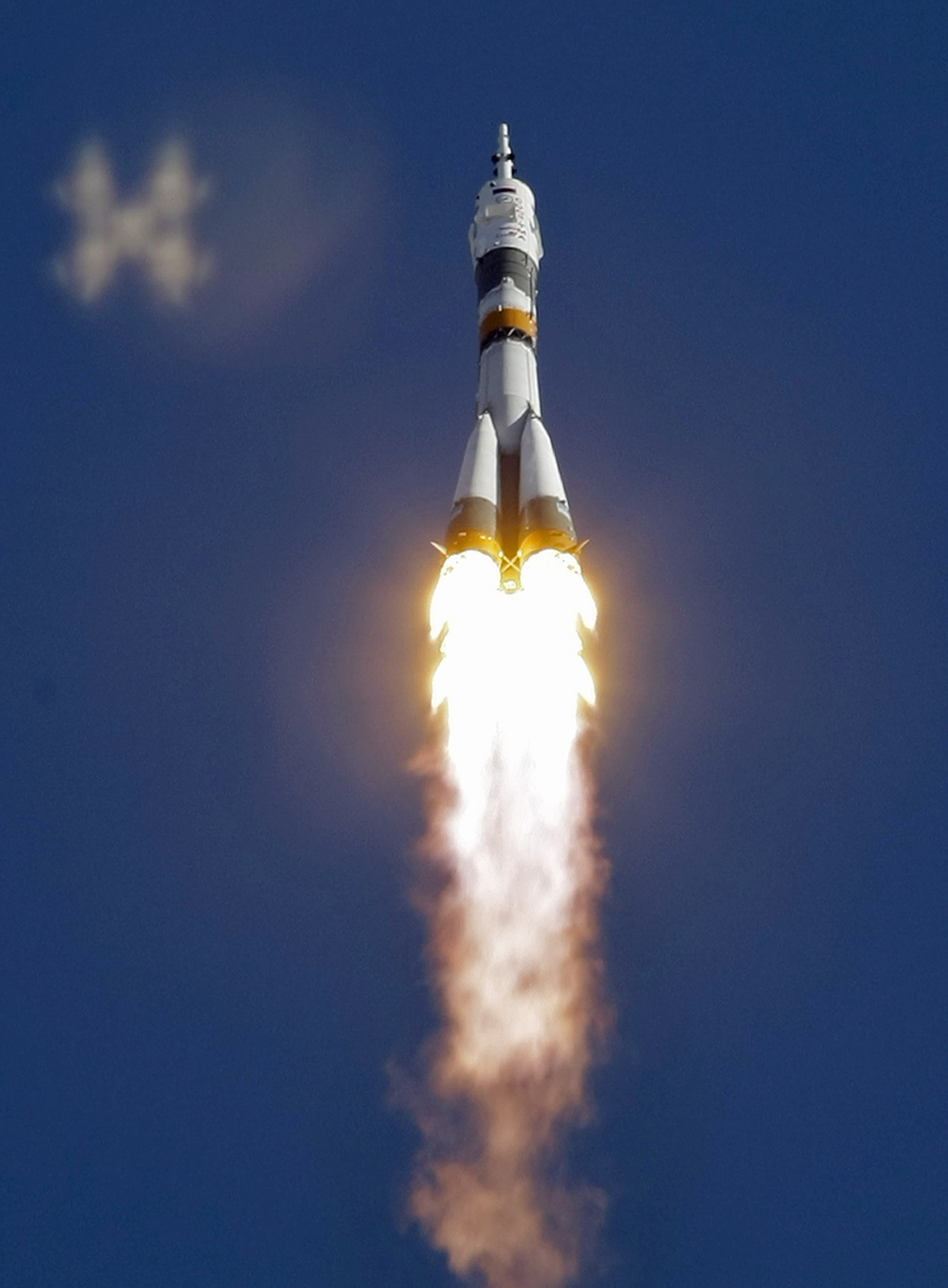 The Soyuz-FG rocket booster with the Soyuz TMA-18 spacecraft carrying a new crew to the international space station (ISS) blasts off from the Russian-...