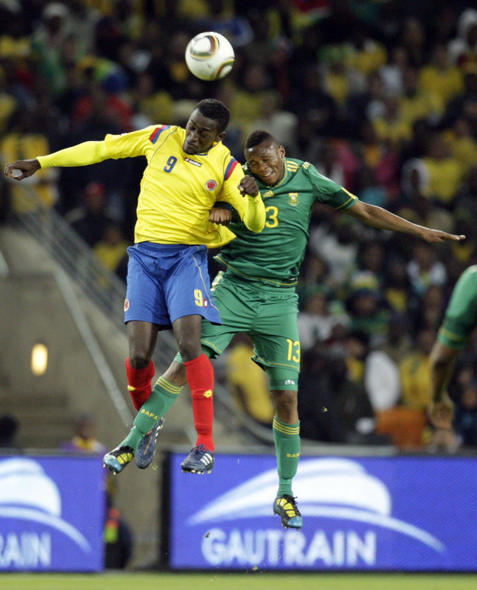 South Africa's Kagisho Dikgacoi, right, defends against Colombia's Jackson Martinez, left, during their international warm-up soccer match at the Socc...