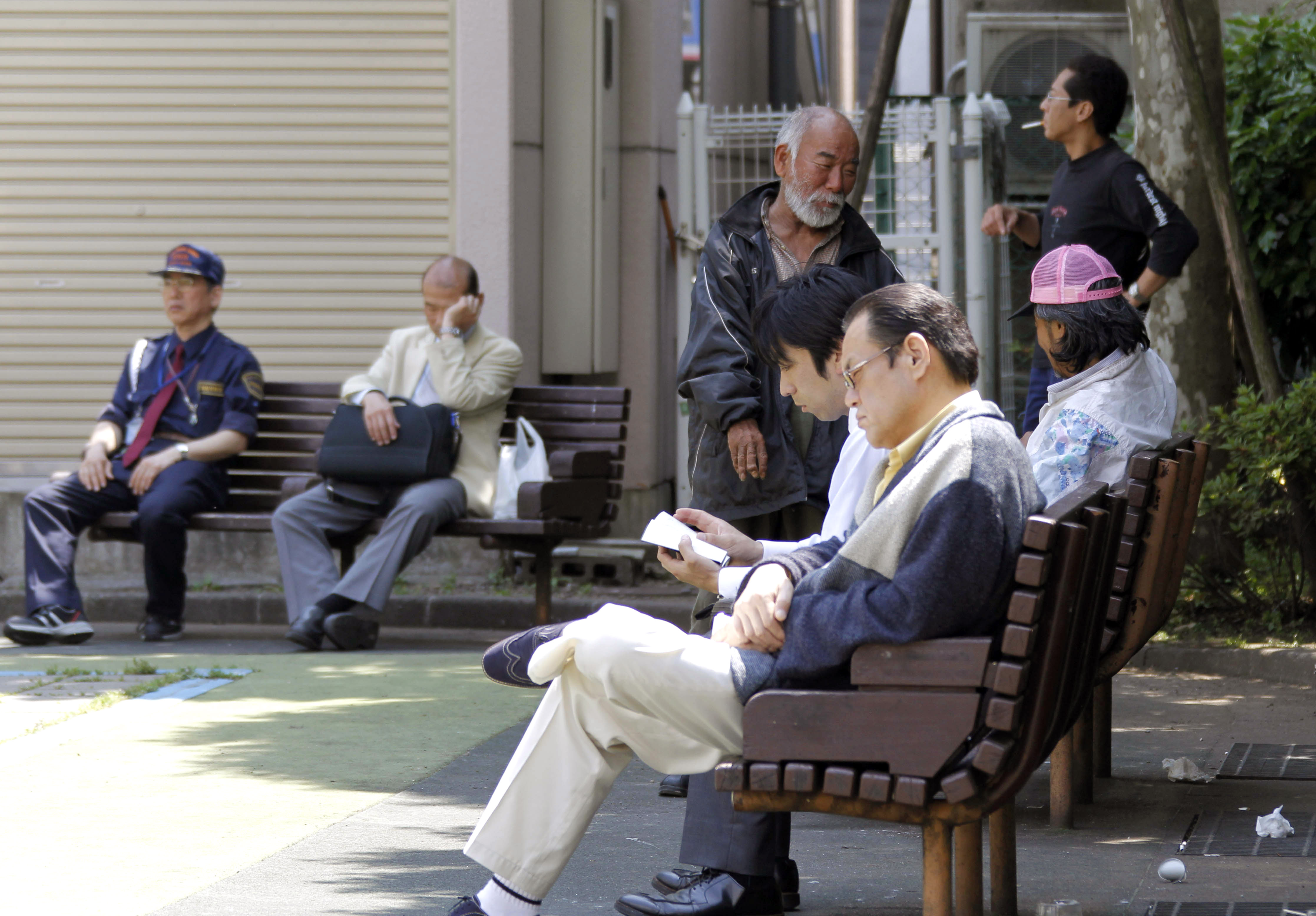 People spend time at a park during midday hours in Tokyo, Japan yesterday. Unemployment rose for the third straight month in April, prices kept slidin...