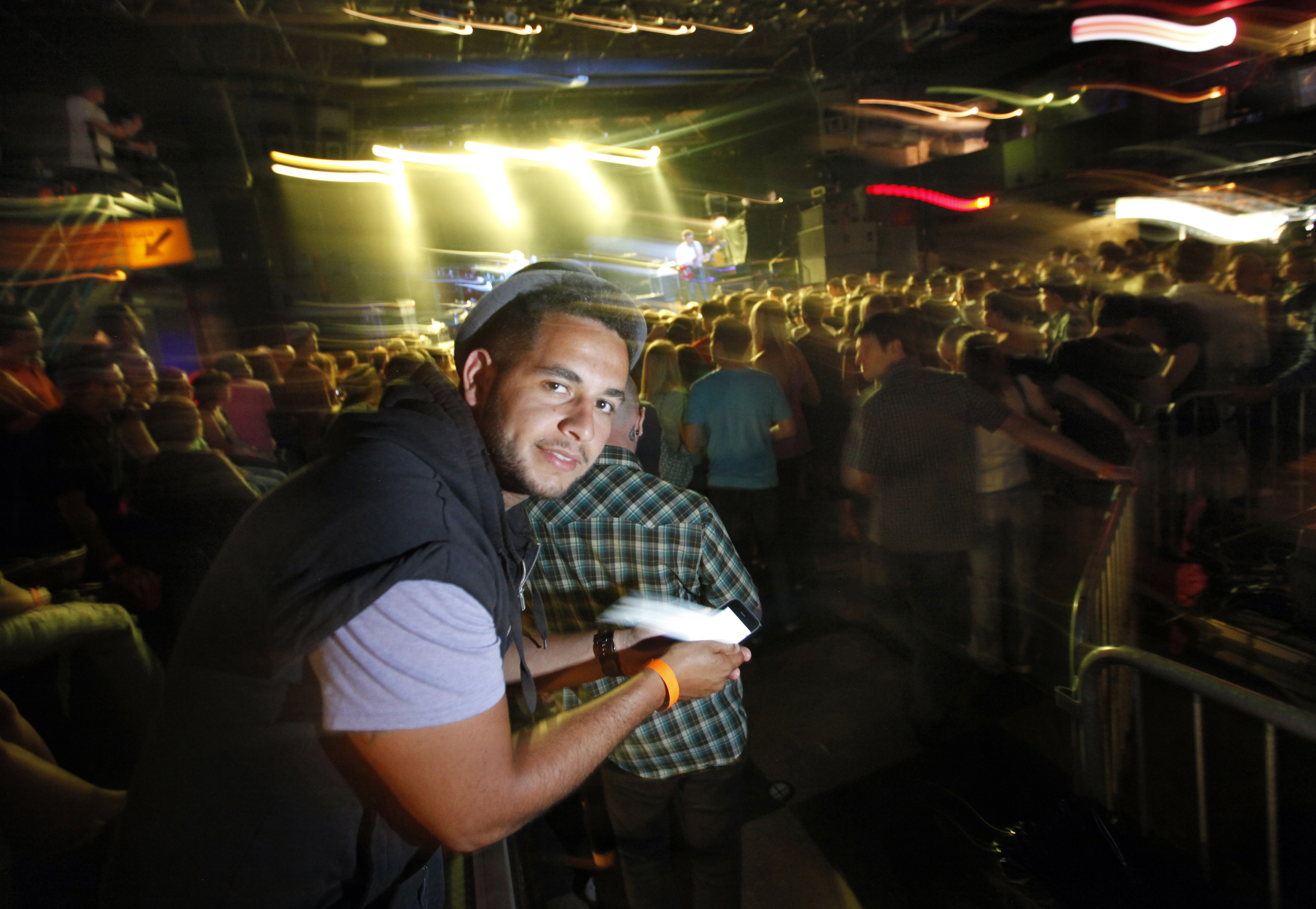Social media user, Kareem Ahmed, arrives inside First Avenue on June 5 in Minneapolis, Minnesota. On his phone, Ahmed checked in on the club's Foursqu...