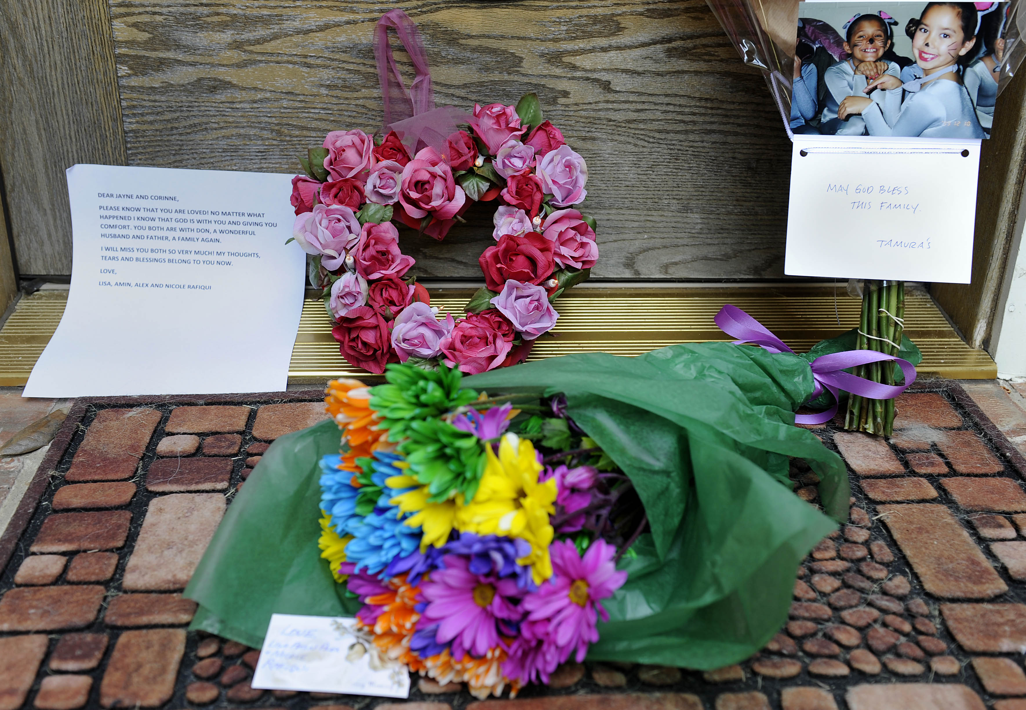 Letters and flowers lay on the front steps of Coppell Mayor Jayne Peters' home Wednesday in Coppell, Texas.