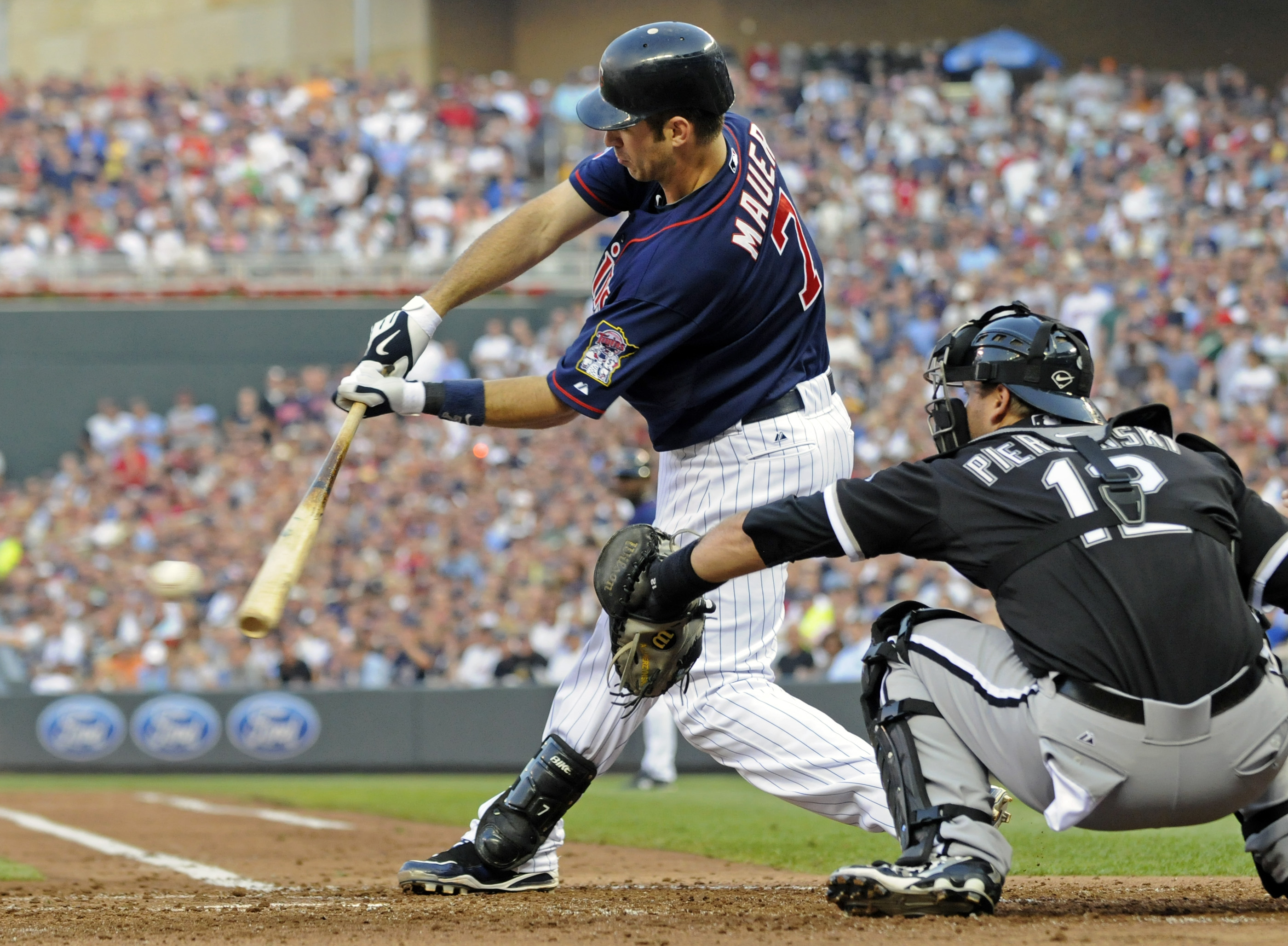 Minnesota Twins' Joe Mauer hits a bases-loaded double off Chicago White Sox pitcher John Danks in the second inning of a baseball game on Thursday in ...
