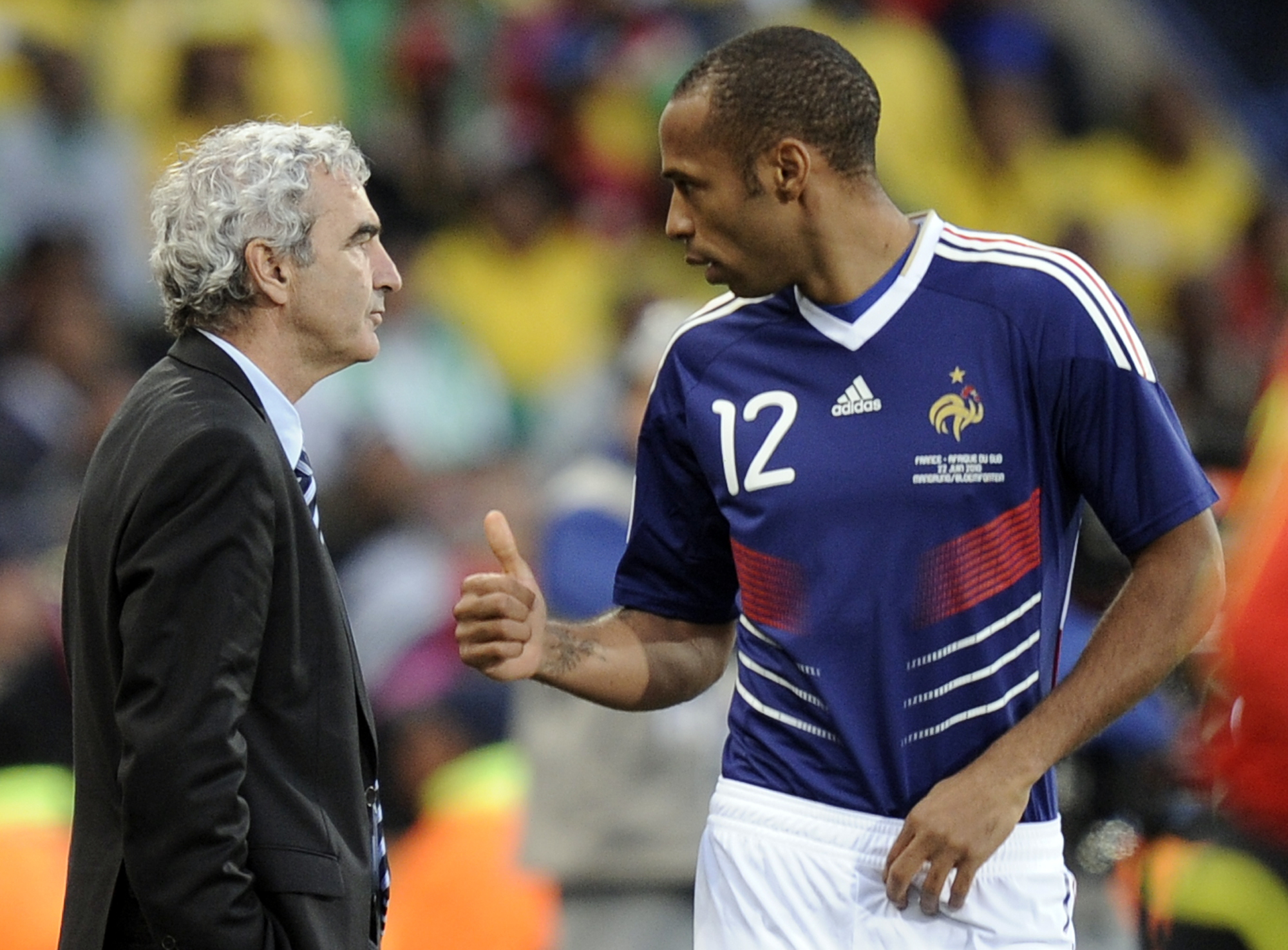 France's Thierry Henry, right, is seen gesturing as France head coach Raymond Domenech left, watches the World Cup group A soccer match between France...