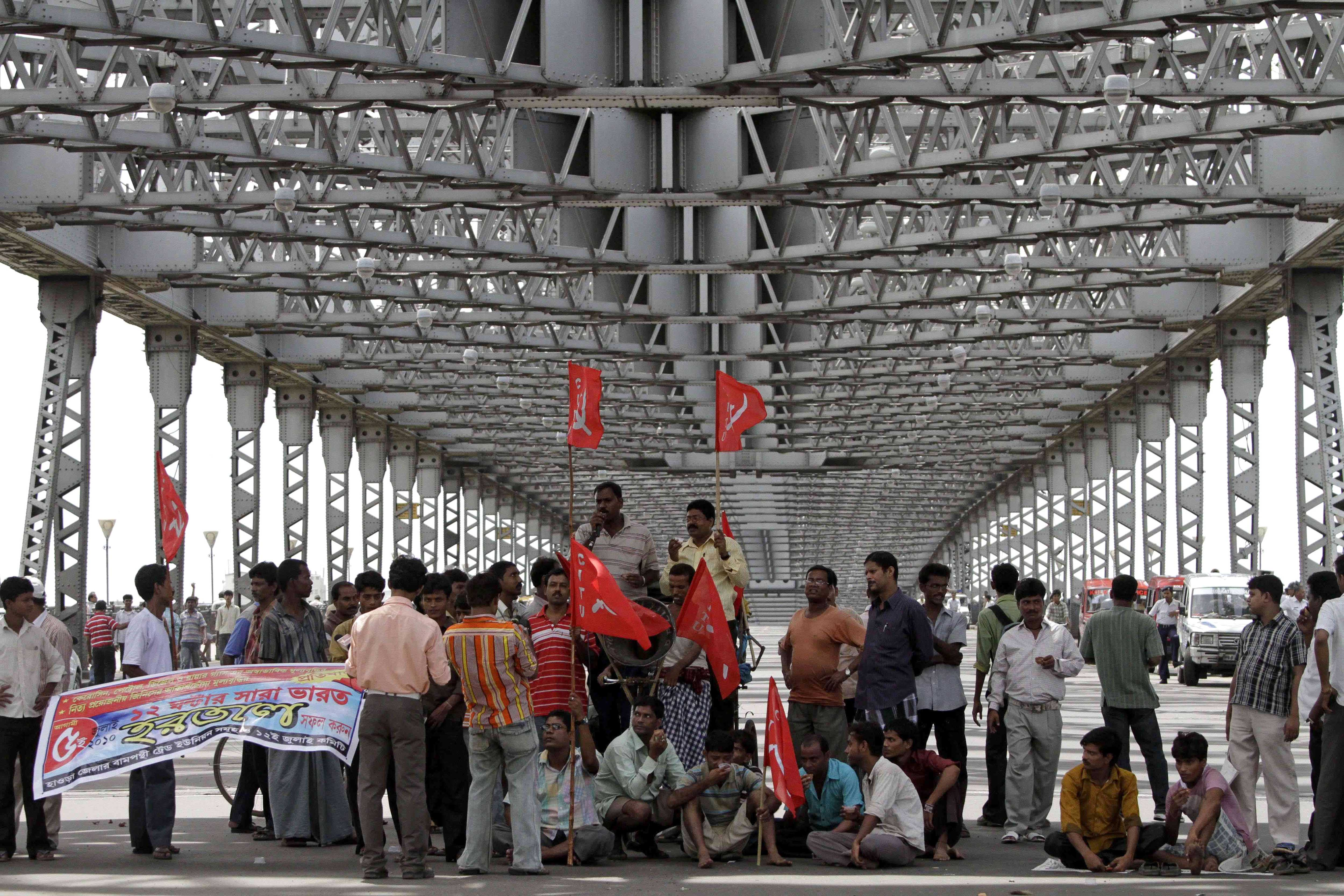 Communist Party of India (Marxist) supporters block traffic on Howrah Bridge over River Ganges during a general strike in Calcutta, India on July 5.