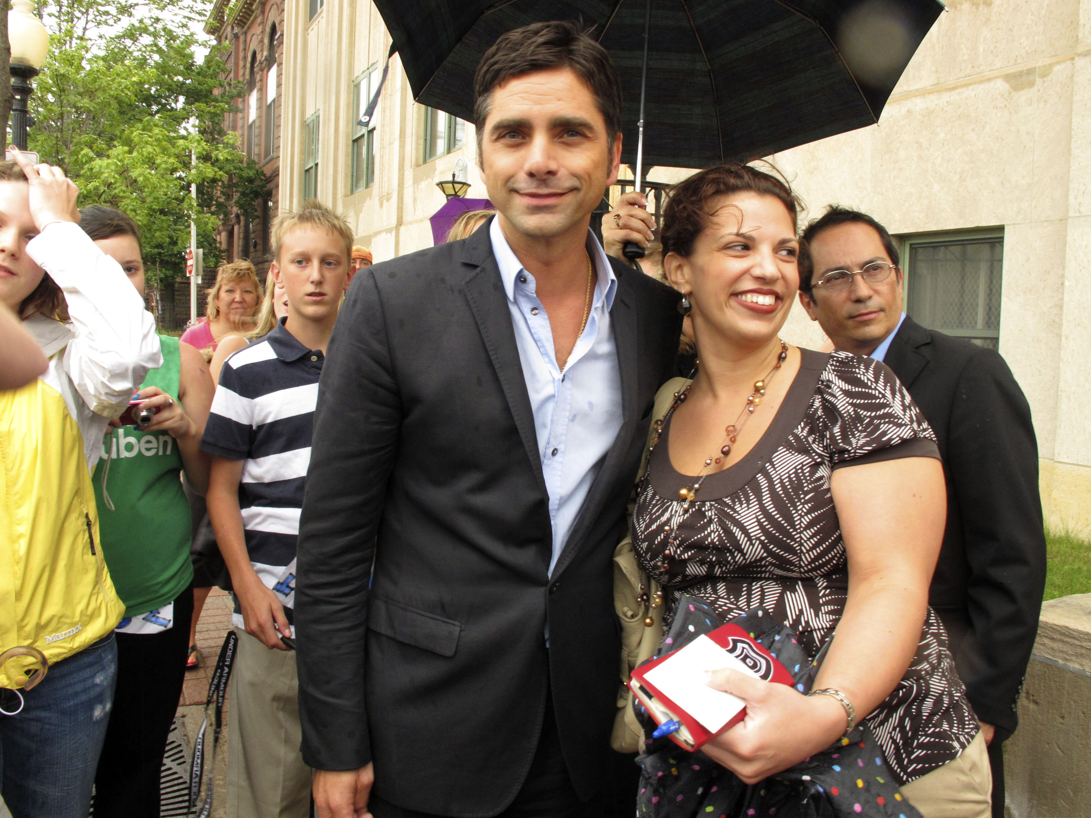 Actor John Stamos greets fans on Wednesday outside the federal courthouse in Marquette, Michigan, during the trial of two people charged with trying t...