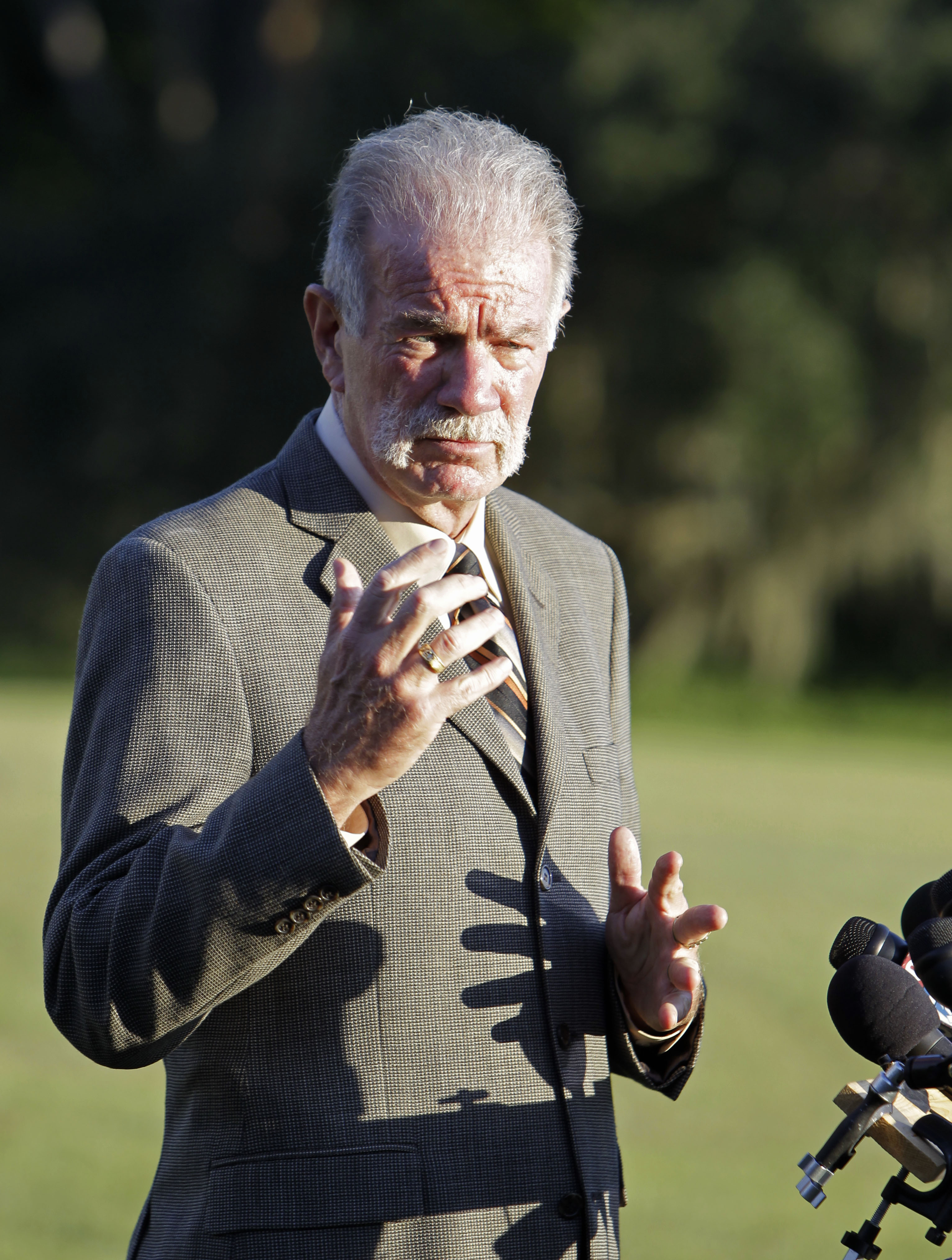 Pastor Terry Jones of the Dove World Outreach Center makes comments to reporters prior to a service at his church in Gainesville, Florida on Wednesday...